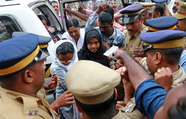 Akhila, 24, who converted to Islam in 2016 and took a new name, Hadiya, arrives at the airport in Kochi,...