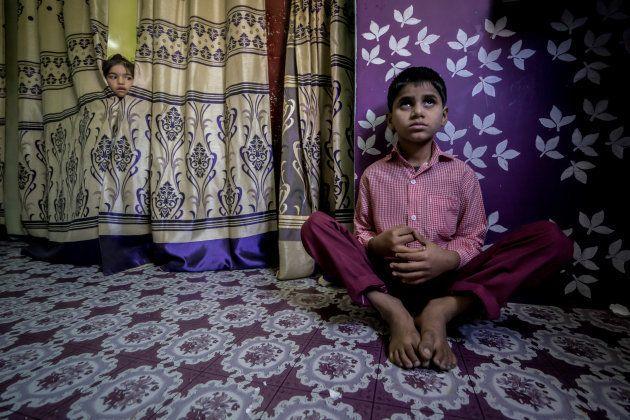 BHOPAL, INDIA: Saiful, 10 years old, at home in the Tila Jamalpura neighborhood. Saiful was born to parents...