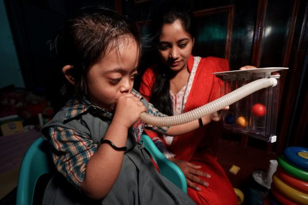 BHOPAL, INDIA: Bushra working with Nousheen, a speech therapist for the Chingari Trust, a unique rehabilitation...