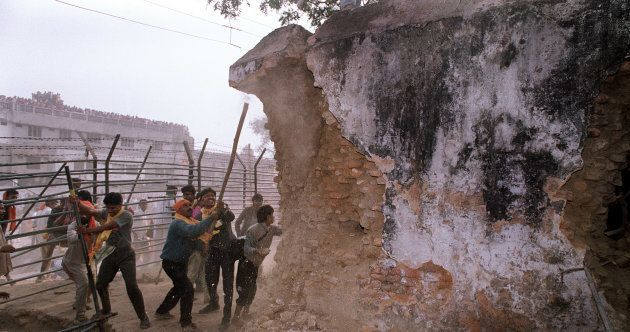 Hindu fundamentalists attack the wall of the 16th century Babri Masjid Mosque with iron rods in the city...