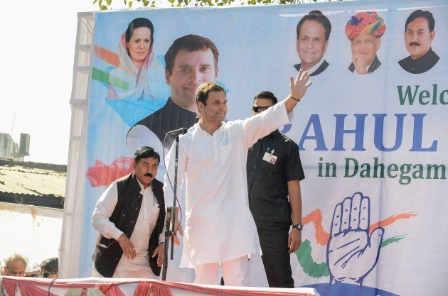 Congress Vice President Rahul Gandhi (C) waves as he arrives to address a rally in Dahegam, some 40km...