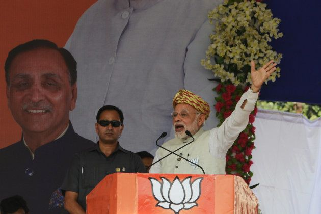 Prime Minister Narendra Modi gestures while addressing a Bhartiya janta Party (BJP) rally at Surendranagar,...