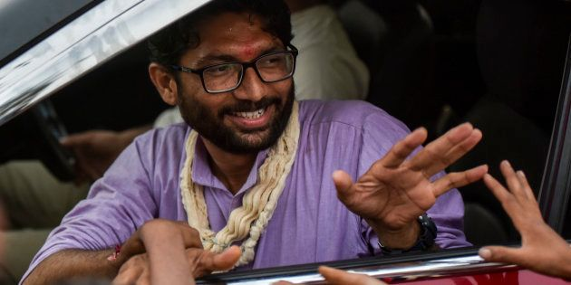 An independent candidate Jignesh Mevani greets people during election campaign on December 10, 2017 in...
