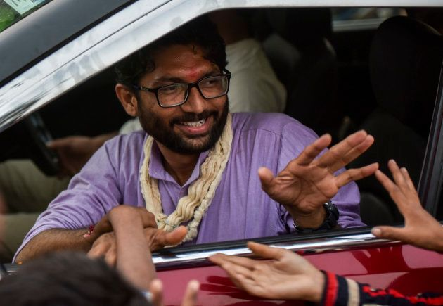 Independent candidate Jignesh Mevani greets people during election campaign on December 10, 2017 in