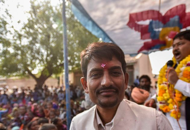 Congress candidate from Radhanpur constituency Alpesh Thakor greets people during election campaign at...