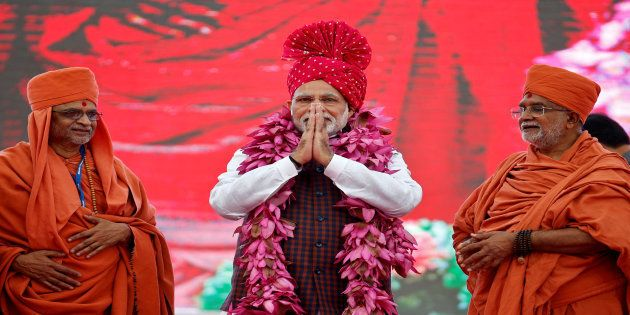 India's Prime Minister Narendra Modi greets his supporters during an election campaign meeting ahead...