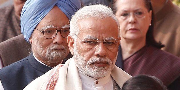 Prime Minister Narendra Modi (C), former Prime Minister Manmohan Singh (L) and Sonia Gandhi, leader of...