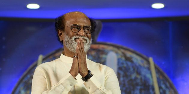 Rajinikanth gestures as he arrives to meets his fans during a interaction session with fans in Chennai...