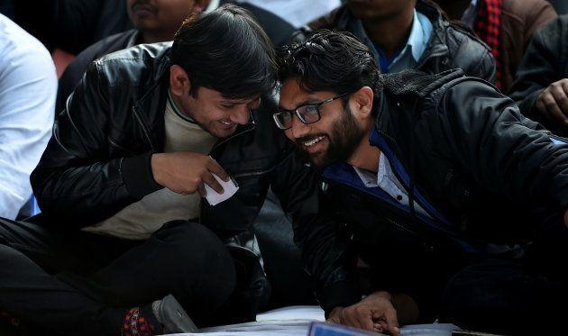 Kanhaiya Kumar and social activists Jignesh Mevani talk during a rally in New Delhi on January 9,