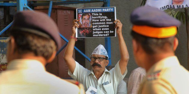 Aam Aadmi Party workers demand inquiry into the death of Justice Loya at Azad Maidan on November 30,...