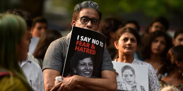 People participate in a protest called 'Not In My Name' against the killing of senior journalist Gauri...