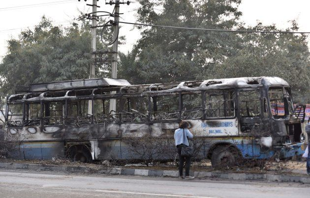 Haryana Roadways bus that was set on fire today near village Bhondsi allegedly by activists of Karni...