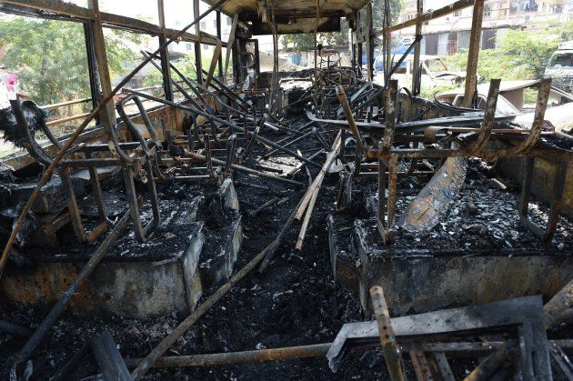 The charred interior of a bus are seen at Sanand town, some 30 kms. from Ahmedabad on January 21,