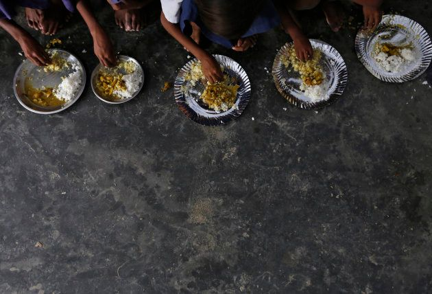 Schoolchildren eat their free mid-day meal, distributed by a government-run primary school at Brahimpur...