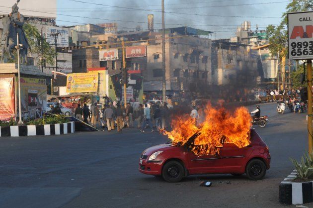 A car set on fire allegedly by Karni Sena to protest release of Bollywood film Padmavat on January 24,...