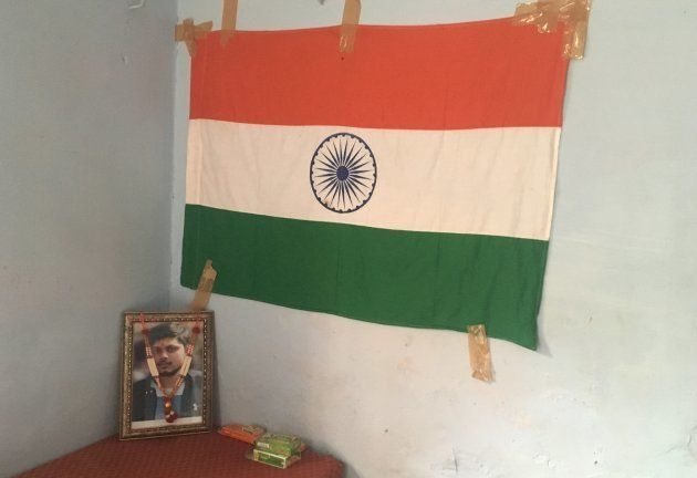 Chandan Gupta's framed photograph at his home in