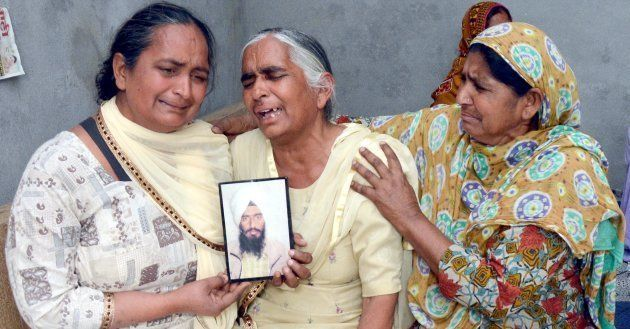 Joginder Kaur grieving the death of her son Gurcharan Singh on March 20, 2018 near Amritsar,
