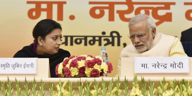 File photo of Prime Minister Narendra Modi talking to I&B Minister Smriti