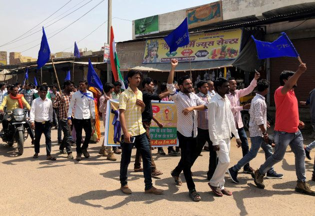 People belonging to the Dalit community shout slogans as they take part in a nationwide strike called...