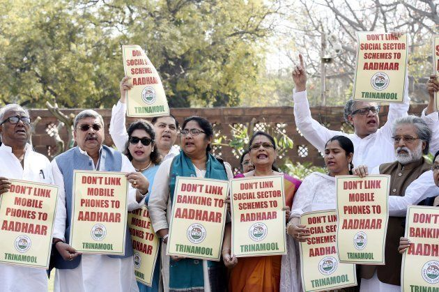 TMC MPs hold placards against implementation of Aadhaar card during Budget Session at Parliament House on March 13, 2018 in New Delhi, India. (Photo by Arvind Yadav/Hindustan Times via Getty Images)