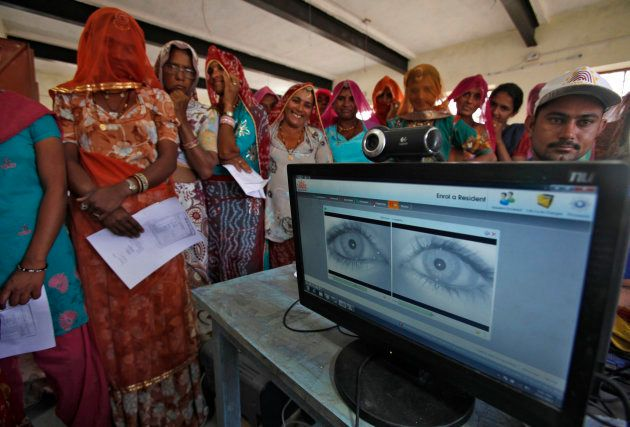 Village women stand in a queue to get themselves enrolled for the Unique Identification (UID) database system at Merta district in the desert Indian state of Rajasthan February 22, 2013.