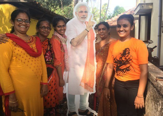 Bhavna Keremata poses with her friends and family next to a cutout of Prime Minister Narendra Modi in Udupi on May 1, 2018.