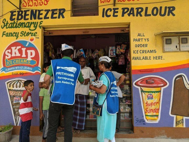 AAP volunteers distribute pamphlets in Bengaluru.
