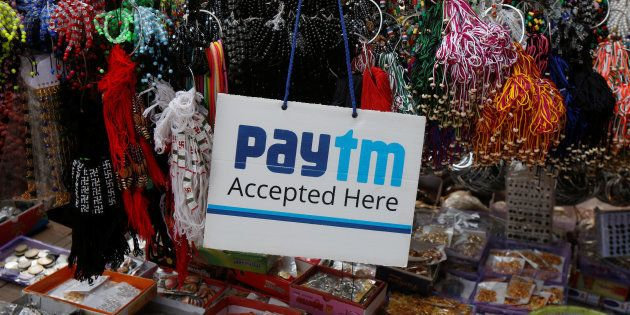 An advertisement of Paytm, a digital wallet company, is pictured at a road side stall in Kolkata, India,...