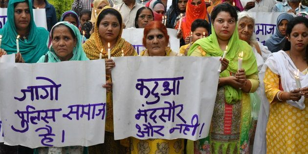 Muslim women take part in a protest against the rapes in Mandsaur and Kathua in Bhopal on July