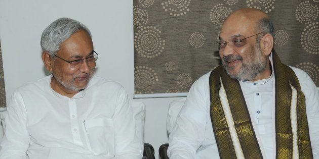 Bihar Chief Minister Nitish Kumar and BJP President Amit Shah exchange greetings at the state guest house...