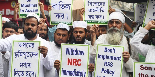 Activists of the Minority Youth Federation shout slogans against the Bharatiya Janata Party (BJP) lead central and Assam state government during a protest rally following the publishing of the first complete draft of the National Register of Citizens (NRC), in Kolkata on July 31, 2018.