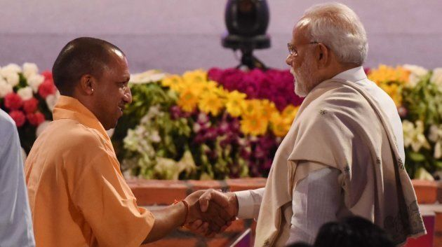 Prime Minister Narendra Modi and Uttar Pradesh Chief Minister Yogi Adityanath greet each other in Lucknow on July 29, 2018 in Lucknow.