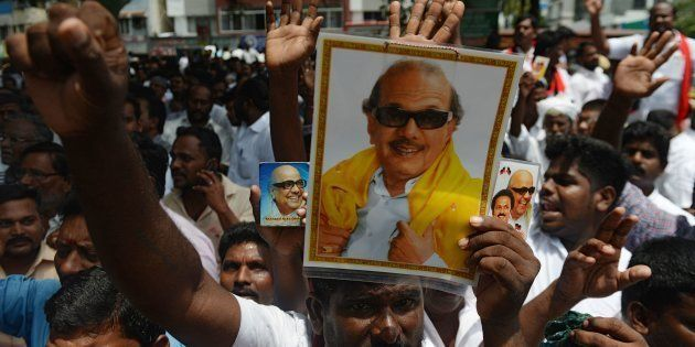Dravida Munnetra Kazhagam (DMK) party supporters displays portraits of party president M. Karunanidhi...