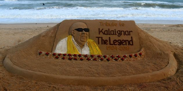 One of a political stalwart M Karunanidhis sand sculpture is seen at the Bay of Bengal Seas eastern coast...