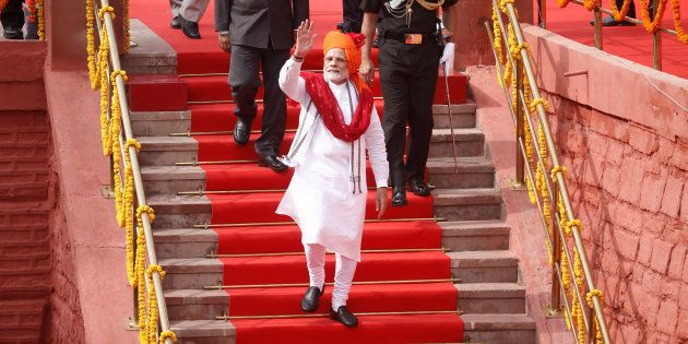 Indian Prime Minister Narendra Modi waves as he leaves after addressing the nation during Independence...