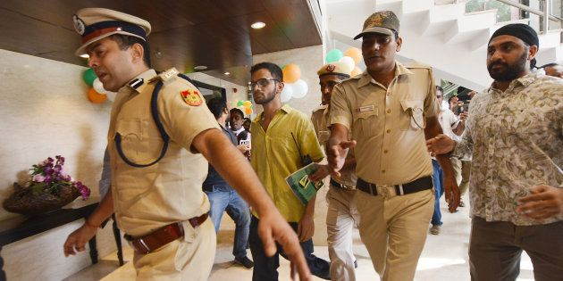 NEW DELHI, INDIA-AUGUST 13: Umar Khalid with police men at the Constitution Club in New Delhi. (Photo by K Asif/India Today Group/Getty Images)