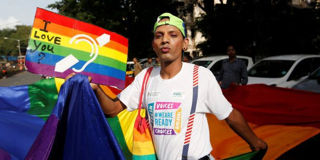 A supporter of the lesbian, gay, bisexual and transgender (LGBT) community holds a placard as he celebrates...