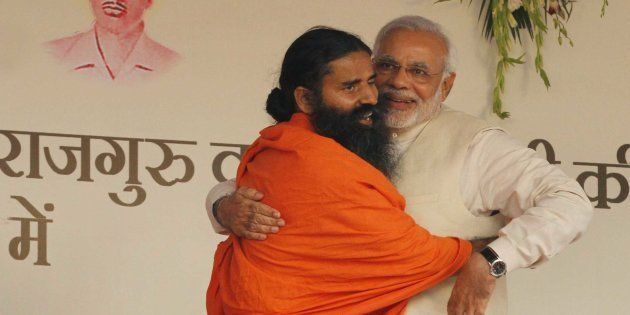 NEW DELHI, INDIA - MARCH 23: BJP prime ministerial candidate Narendra Modi and yoga guru Baba Ramdev...