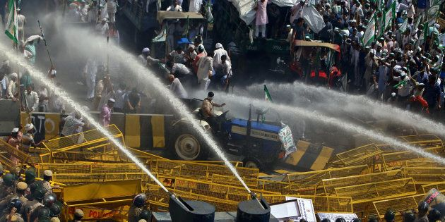 Police use water cannons to disperse farmers during a protest demanding better price for their produce...