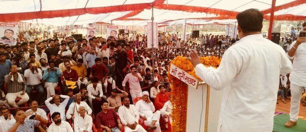 UP Navnirman Sena chief Amit Jani address an election rally to promote men accused of lynching Muslims...