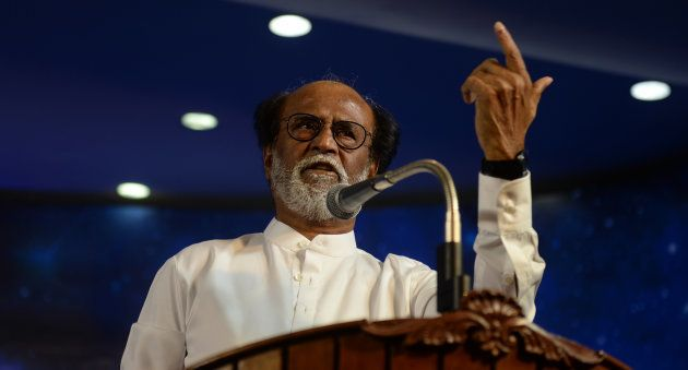 Indian film actor Rajinikanth gestures as he announces his entry in politics during an interaction session...