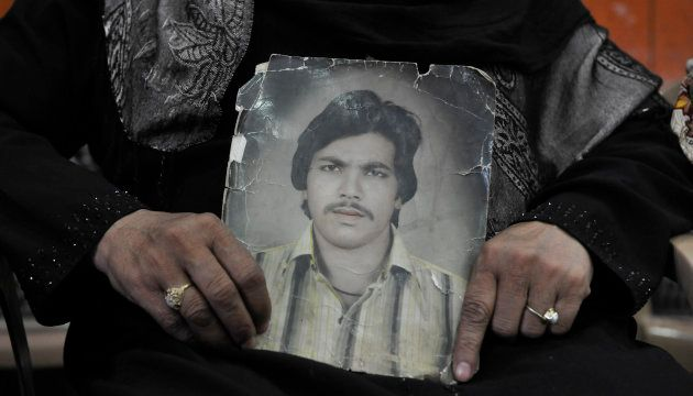 Zehbunisha shows picture of her husband wife of Mohd Iqbal who was killed in 1987 Hashimpura massacre...