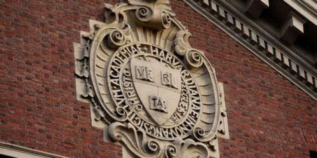 A seal hangs over a building at Harvard University in Cambridge, Massachusetts, U.S., November 16, 2012....