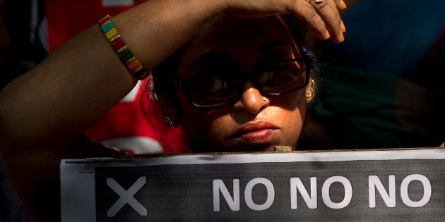 An Indian women holds a banner during a protest against sexual harassment in the workplace in New Delhi,...