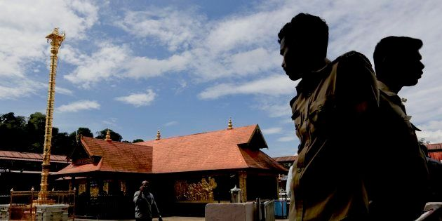 Policemen stand guard at the Sabarimala temple in Kerala this week. A local tribal community called Mala...