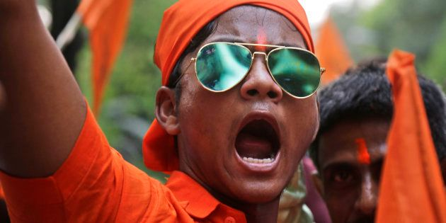 An activist of India's ruling Bharatiya Janata Party (BJP) shouts slogans as he participates in a religious...