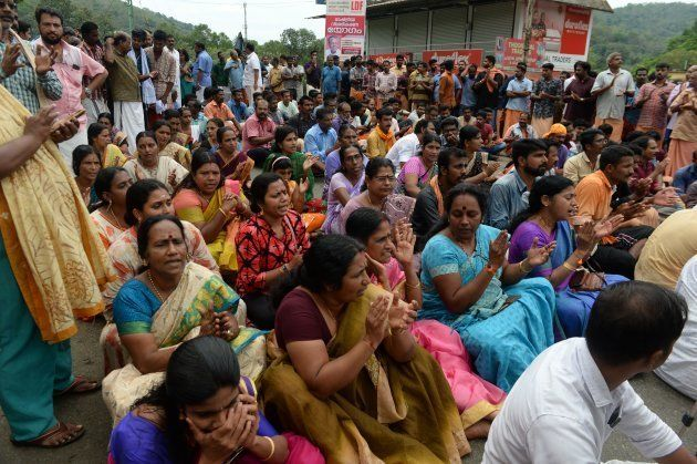 Activists block the road to the Sabarimala Temple in Pathanamthitta in October. In the silence or the...