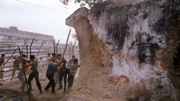 Karsevaks attack the wall of the Babri Masjid on December 6,