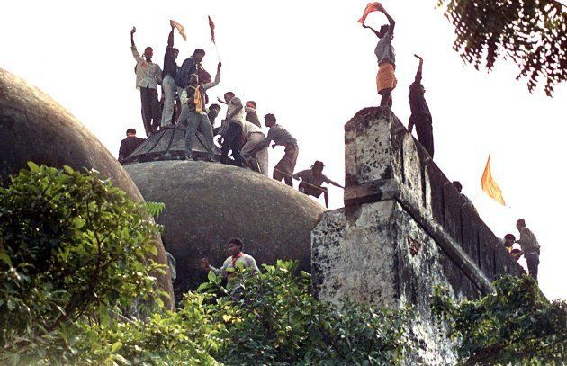 Hindu youths atop the 16th century Muslim Babri Mosque on 06 December, 1992.