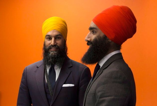NDP leader Jagmeet Singh and his brother Gurratan Singh pose for a photo at the party offices in Ottawa...